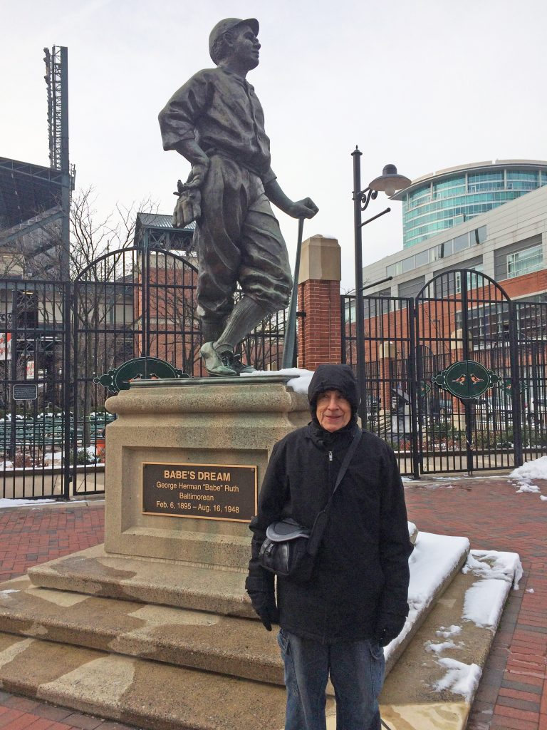 A statue of Babe Ruth in the Baltimore Inner Harbor area