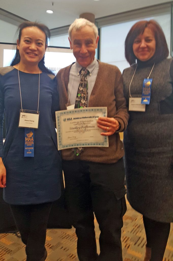 Dr. Stanley Rothman, aka Dr. Stan the Stats Man receiving a certificate at the 2019 Joint Math Convention in Baltimore, MD