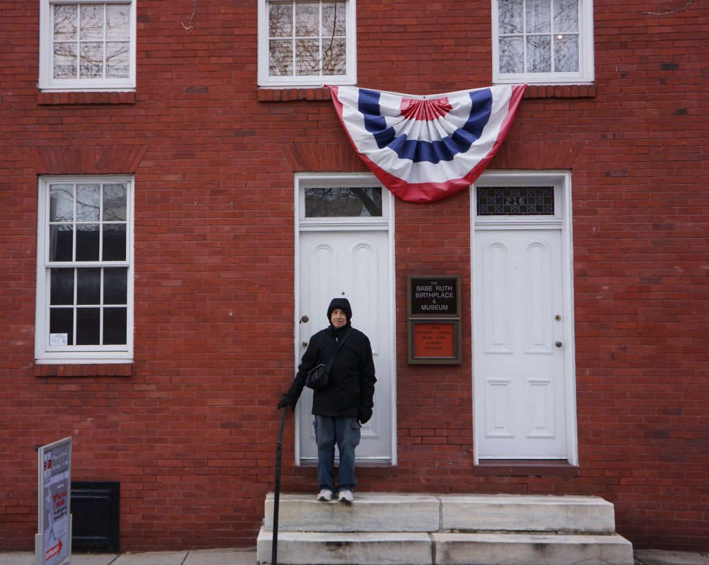 Dr. Stanley Rothman, aka Dr. Stan the Stats Man in front of the Babe Ruth Museum and birthplace